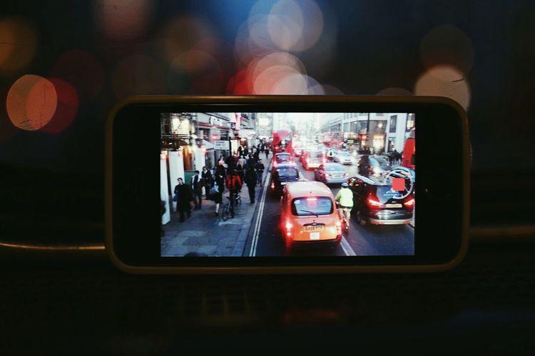 Close-up of cars in illuminated bus
