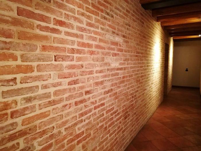 View of illuminated brick wall