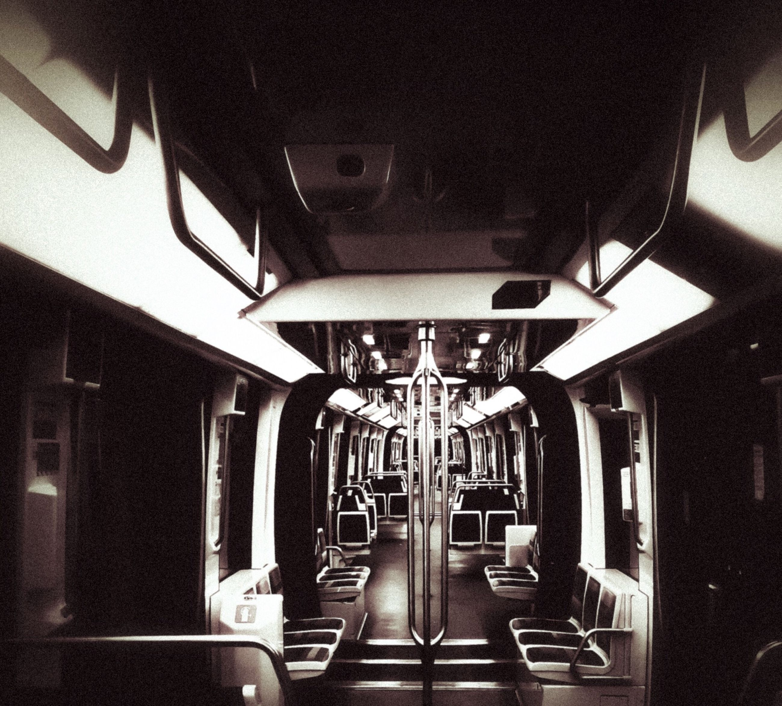 indoors, transportation, architecture, illuminated, built structure, mode of transport, absence, empty, lighting equipment, land vehicle, no people, ceiling, the way forward, car, stationary, incidental people, building, public transportation, travel, day
