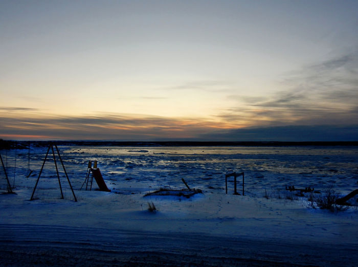 Playground by the lake in Kuujjuaq, Quebec at sunset Cold Temperature Sky Snow Sunset Winter Scenics - Nature Beauty In Nature Tranquility Nature Tranquil Scene Land Water Frozen Cloud - Sky No People Sea Horizon Environment Ice Horizon Over Water Outdoors Kuujjuaq Nunavik Far North Quebec