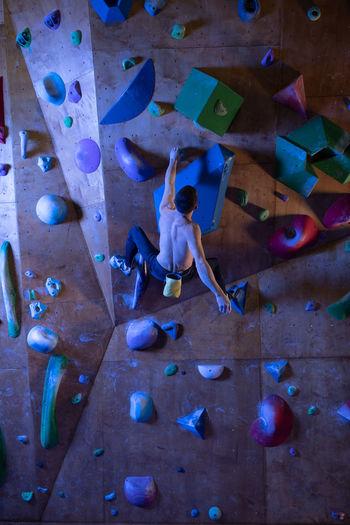 High angle view of man climbing on wall