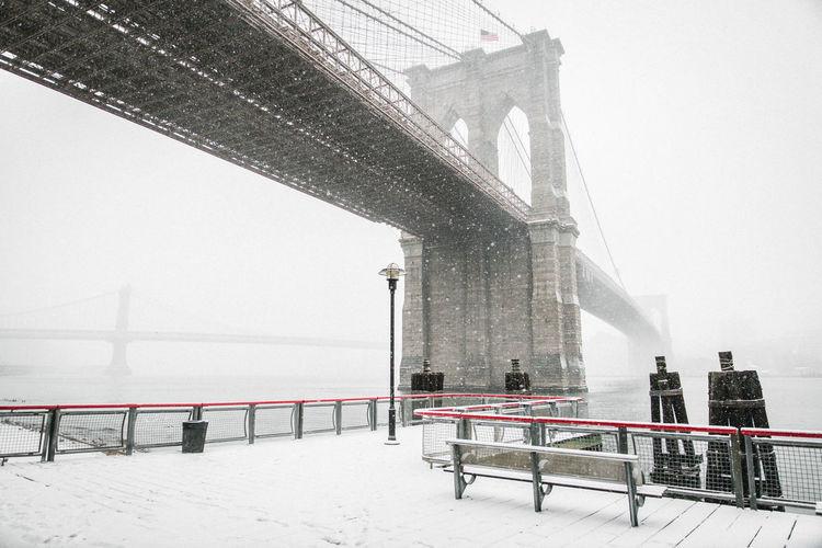Low angle view of brooklyn bridge in winter