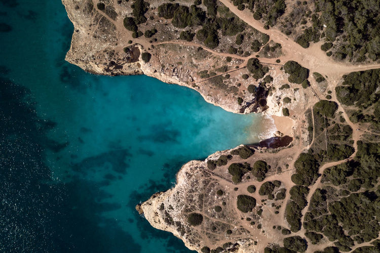 Water Sea Nature Rock Outdoors Geology Beach Turquoise Blue Moody Landscape Scenics Travel Destination Algarve Europe Day Land Coastline Aerial View Vegetation Autumn Fall Tourism Pathway