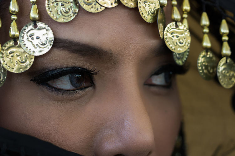 Cropped image of mid adult woman wearing headdress