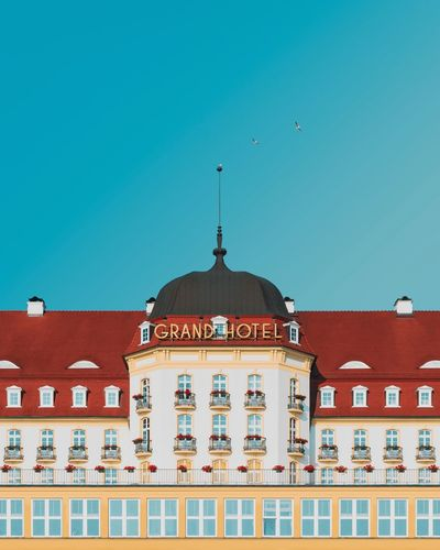 🔹🏰🔹︱Grand Anderson Minimalist Architecture Minimal Exterior Symmetry EyeEm Best Shots EyeEmNewHere First Eyeem Photo EyeEm Selects Windows Hotel Blue Sky Architecture_collection Cloud - Sky VSCO The Week on EyeEm Symmetrical Politics And Government Clear Sky Dome Roof Multi Colored Palace Sky Architecture Building Exterior Built Structure Façade King - Royal Person Rose Window Entrance The Architect - 2018 EyeEm Awards
