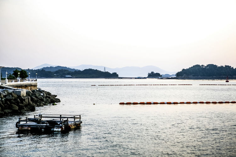 Aquaculture Boat Calm Clear Sky Island Lake Nautical Vessel Ocean Outdoors Pier Rippled Scenics Sea Tranquil Scene Tranquility Water Waterfront Yeousu