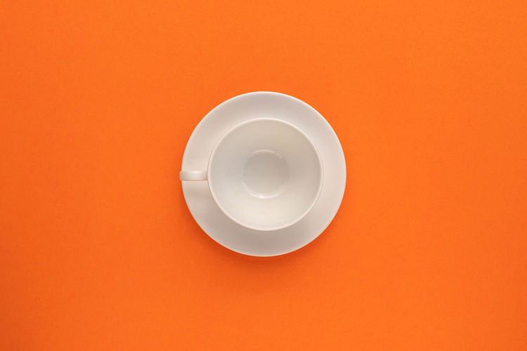 High angle view of bread in orange background