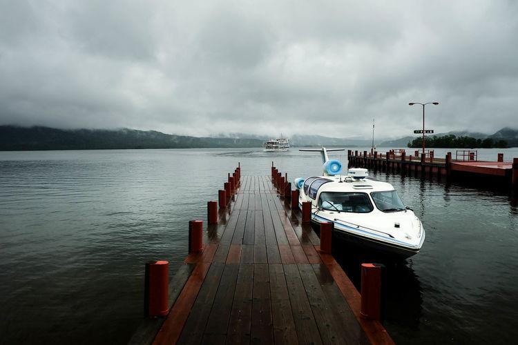 Motorboat Moored At Pier On Caldera Lake At Akan National Park