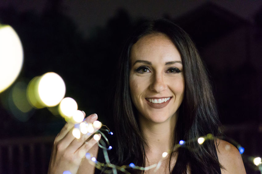 Adult Beautiful Woman Cheerful Close-up Focus On Foreground Happiness Headshot Illuminated Light Strings Lights In The Dark Looking At Camera One Person Portrait Smiling Young Women