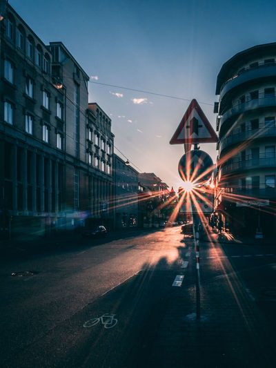 City Sunburst Architecture Building Building Exterior Built Structure Car City Dusk Golden Hour Illuminated Land Vehicle Mode Of Transportation Modern Motor Vehicle No People Outdoors Road Sky Street Street Light Streetphotography Transportation The Street Photographer - 2018 EyeEm Awards