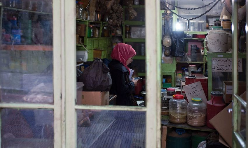 Palestinian girl in a local shop in Nablus, Palestine. Real People Men Occupation Working Women Day Factory Industry One Person Indoors  Manual Worker Adult People Palestine Everyday Girl Palestinian Local Market Shop