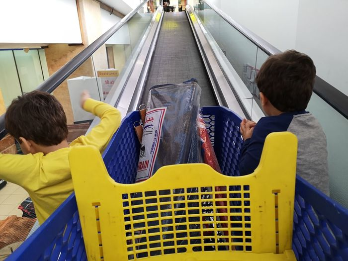 Childhood Child Togetherness Women Yellow Rear View High Angle View Escalator Moving Walkway