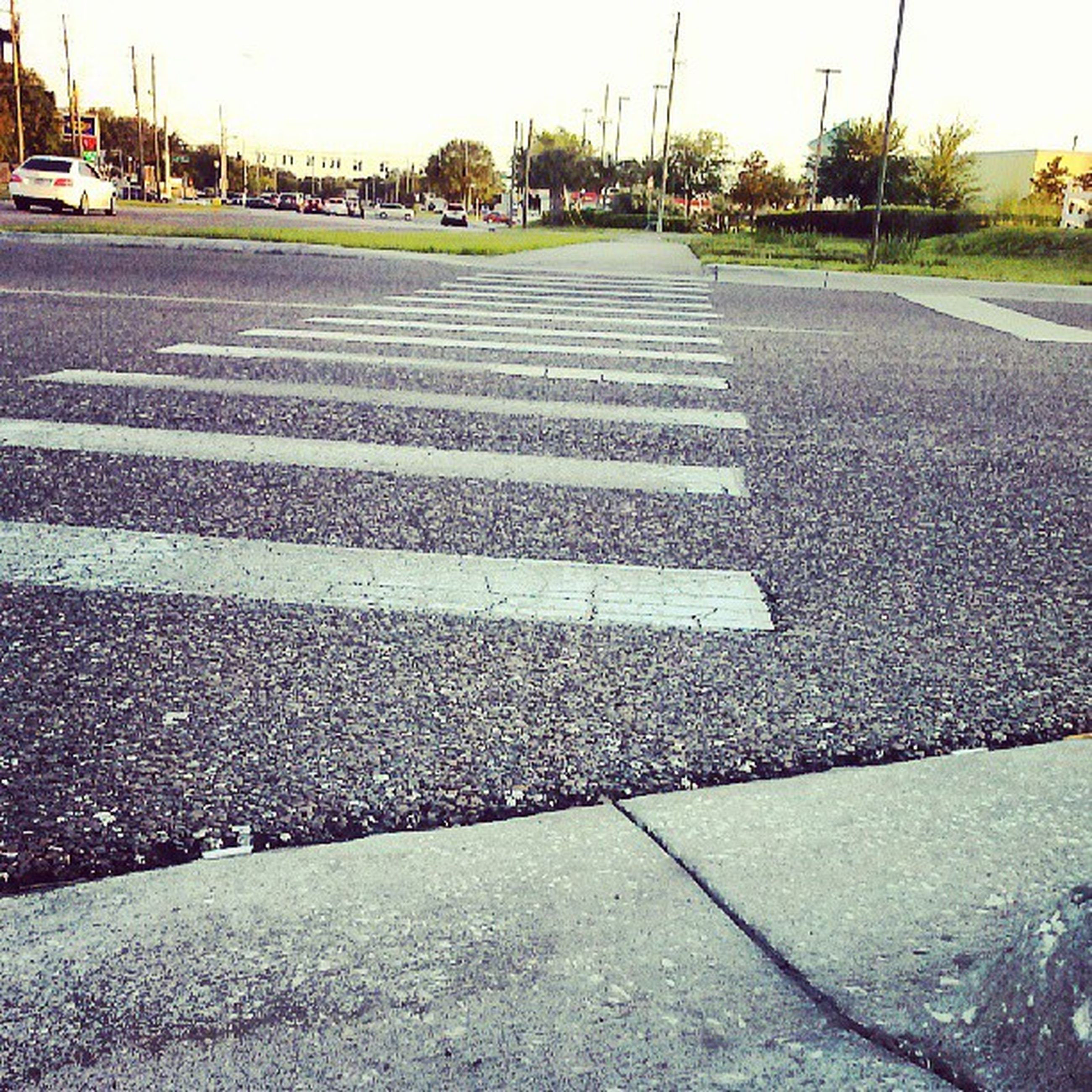 transportation, road marking, asphalt, road, the way forward, street, surface level, diminishing perspective, vanishing point, car, empty, day, outdoors, empty road, no people, mode of transport, dividing line, land vehicle, city, sidewalk