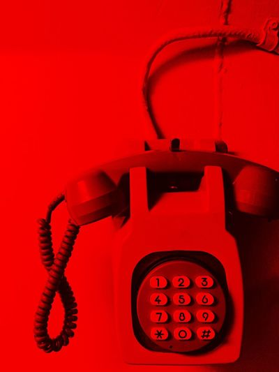 Emergency telephone, red light Alarm Buttons Call Calling Close-up Communication Convenience Dial Electricity  Electronics  Emergency Handset Headphones Man Made Object Numbers Old-fashioned Phone Red Technology Telephone URGENT Vibrant Color Vintage Wall Warning