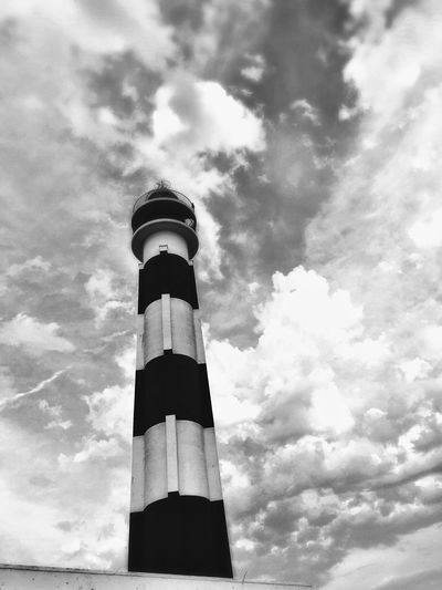 Al faro Travelling Monotone Monochrome Blackandwhite Dramatic Sky Lighthouse Low Angle View Cloud - Sky Sky Tall - High Tower Architecture Day Building Exterior Guidance Lighthouse No People Built Structure Nature Outdoors