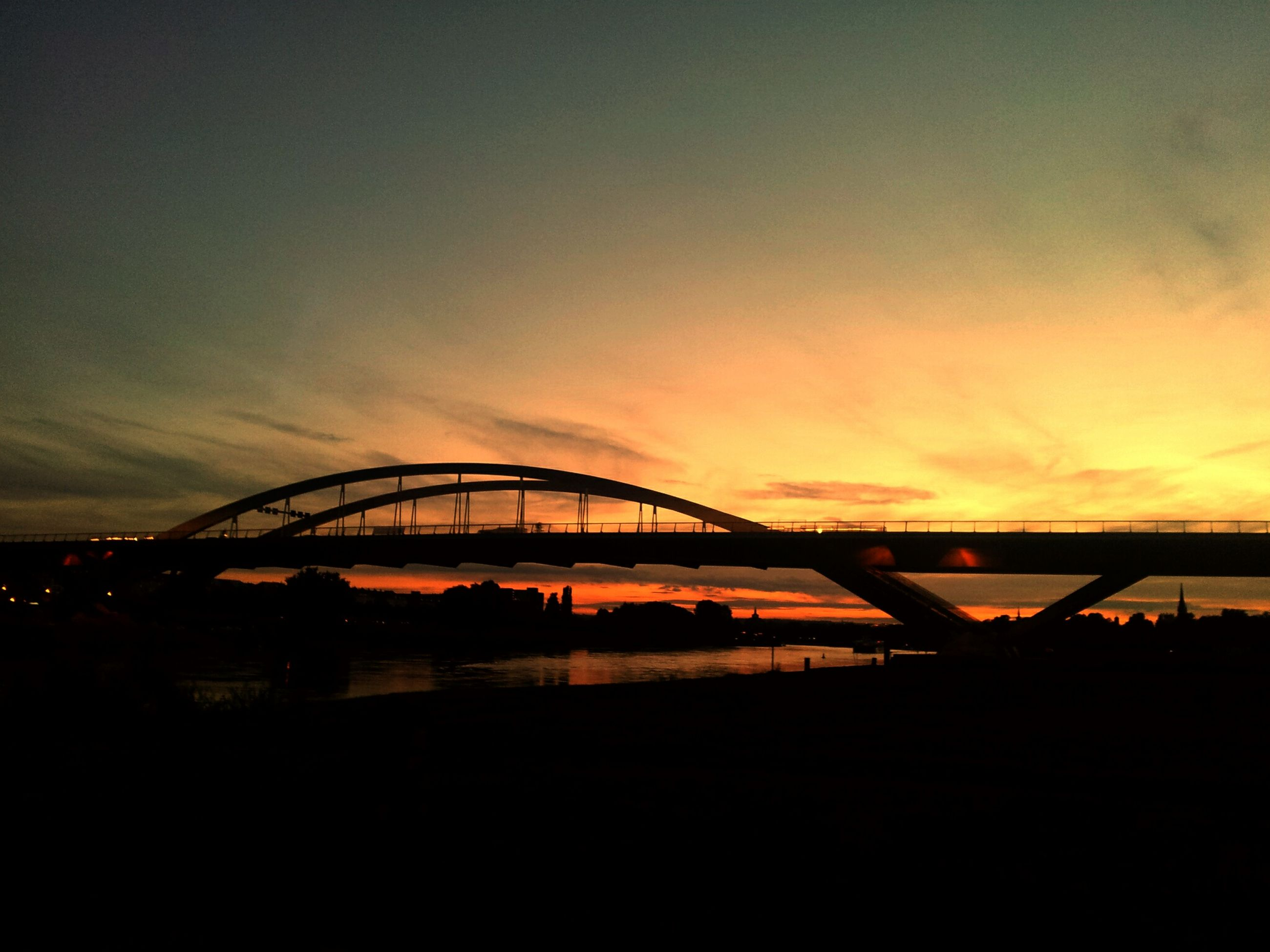 sunset, silhouette, connection, sky, bridge - man made structure, orange color, built structure, architecture, cloud - sky, bridge, engineering, river, sun, nature, scenics, dusk, cloud, tranquility, beauty in nature, no people