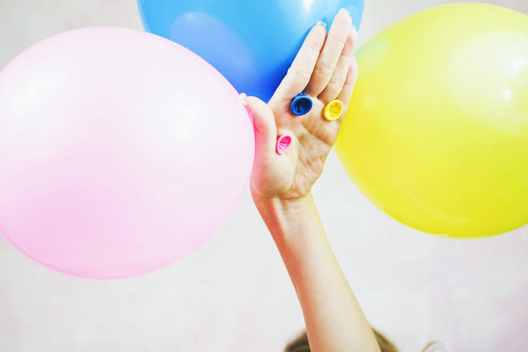 Balloon Childhood Child One Person Pink Color Multi Colored Holding Real People Vulnerability  Fragility Body Part Human Body Part Indoors  Women Focus On Foreground Young Celebration Innocence Baby Human Limb Human Arm Arms Raised Party Event Funny Plastic Ball Abstract Concept Color Pastel Colored Pastel Colors Hanging 3