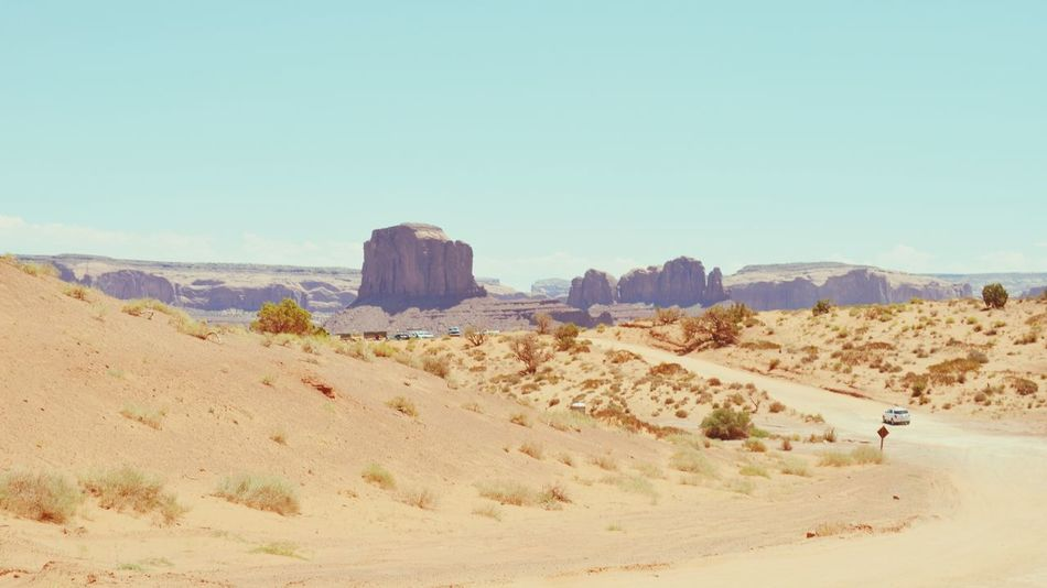 Monument Valley Summer Road Tripping Sand Dune Desert Clear Sky Arid Climate Sand Sky Landscape Depression - Land Feature Arid Landscape Rocky Mountains Arid Eroded Rock Rock Formation Extreme Terrain