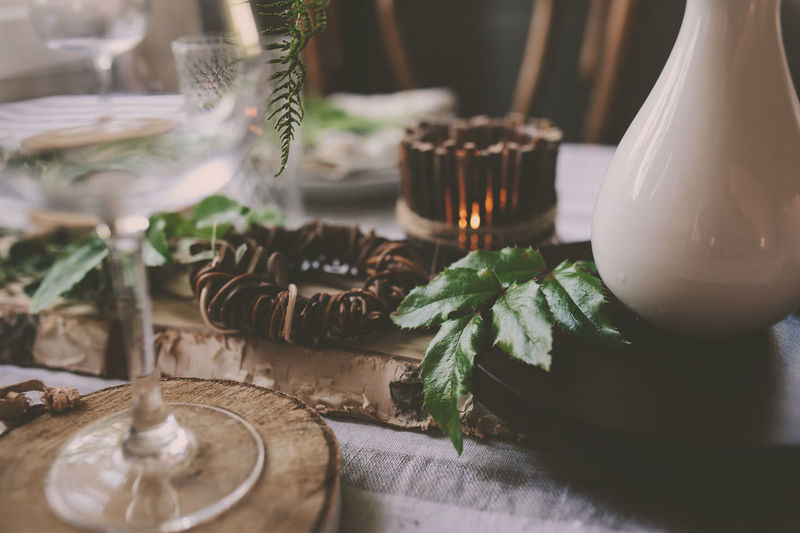 summer table setting in natural organic style with handmade details in green and brown tones. Country living concept Table Indoors  No People Plate Festive Rustic Table Setting Wild Fern Dinner Country Life Country House Kitchen Interior Rustic Interior Decoration Natural Style Forest Wineglass Organic Handmade Summer