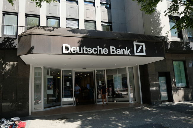 Mannheim, Germany - August 23, 2017: Deutsche Bank sign outside a local branch. It is a German global banking and financial services company with its headquarters in Frankfurt Business Deutsche Bank Bank Banking Building Exterior Business Entrance Finance Financial Money Outdoors Saving Money Savings
