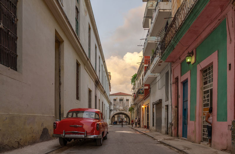 Havana street capture Architecture Building Exterior Built Structure Transportation City Mode Of Transportation Building Street Car Motor Vehicle Residential District Road Outdoors Alley Cloud - Sky Havana Cuba Classic Car Oldtimer