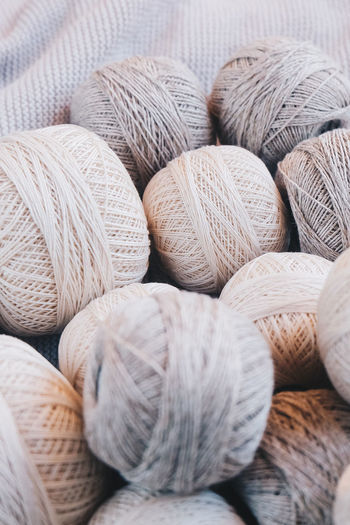 Textile Still Life No People Close-up Indoors  Ball Of Wool Wool Art And Craft Material Backgrounds Craft Full Frame Large Group Of Objects Variation Choice Softness Selective Focus Textured  Pattern Multi Colored Abundance Neutral Colors Yarn Yarn Balls Cotton Cotton Balls Strings