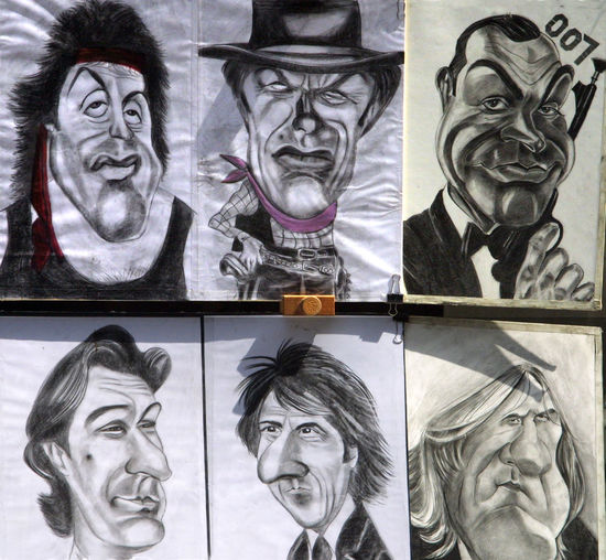 Dustin Hoffman Florence, Italy Sean Connery Adult Charicature Clint Eastwood Close-up Day Human Body Part Human Face Human Representation Indoors  Multiple Image People Silvester Stallone Smiling Street Artistry Young Adult