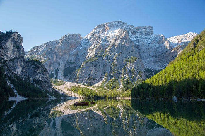 View over Lago di Braies at the morning. Alto Adige Dolomites Dolomites, Italy Beauty In Nature Clear Sky Day Dolomiti Lago Di Braies Lake Mountain Mountain Range Nature No People Non-urban Scene Outdoors Pragser Wildsee Pragserwildsee Reflection Scenics Sky South Tyrol Sunlight Tranquil Scene Tranquility Tree Water