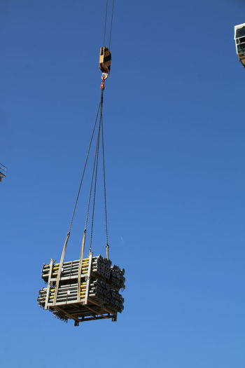 Clear Sky Flying Blue Hanging Business Finance And Industry Mid-air Crane - Construction Machinery Sky Close-up