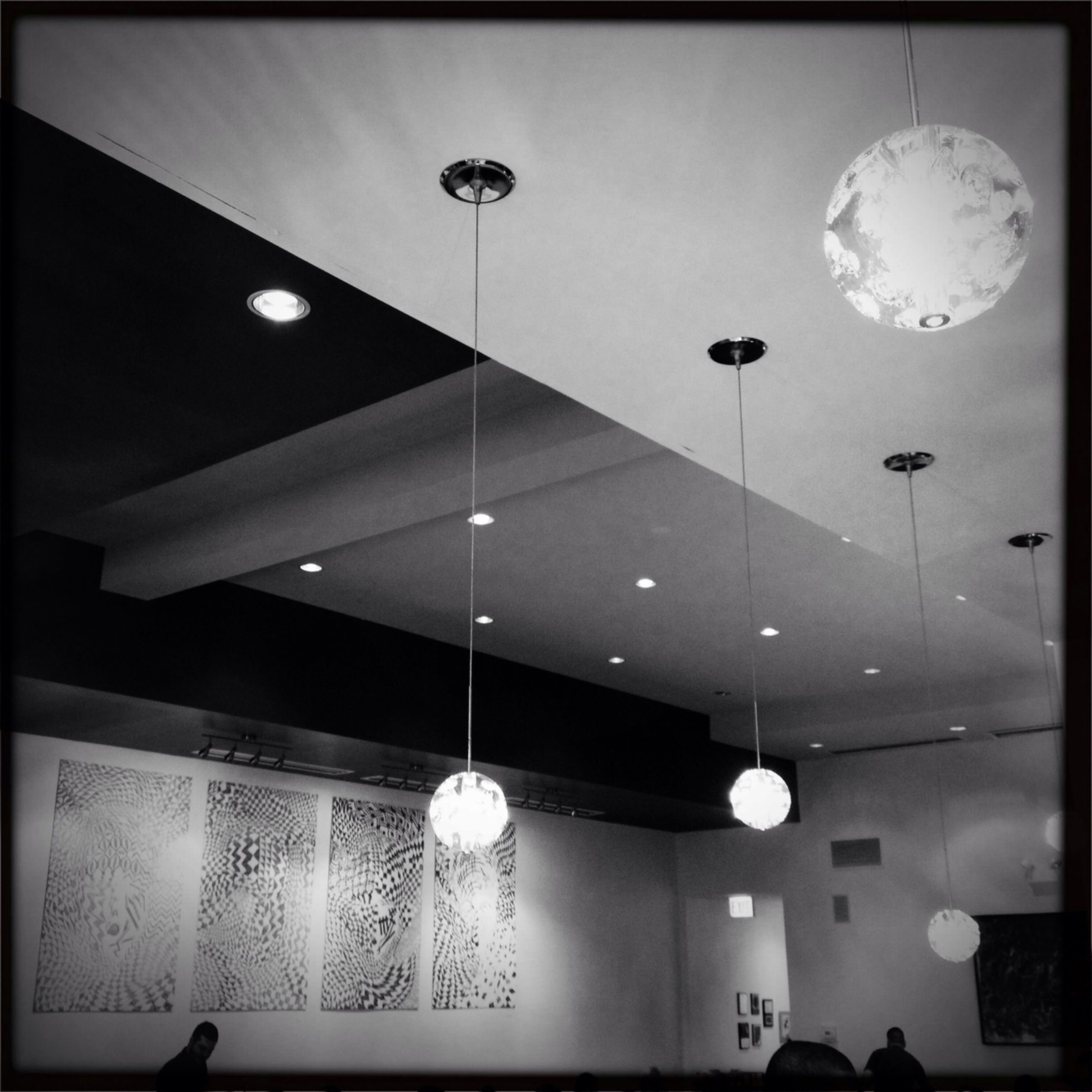 indoors, illuminated, lighting equipment, ceiling, hanging, electric lamp, electricity, electric light, chandelier, low angle view, decoration, light bulb, lamp, built structure, home interior, pendant light, light - natural phenomenon, architecture, night, in a row