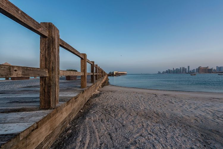 Beach Bridge Water Sea Sky Beach Architecture Nature Land Built Structure Clear Sky Tranquility No People Blue Scenics - Nature Tranquil Scene Beauty In Nature Day Outdoors