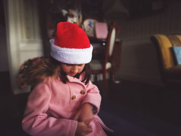 santa hat and pink coat. Christmastime Santa Hat Santa Holidays EyeEm Selects Child Girls Children Only One Person One Girl Only Childhood People Warm Clothing Indoors  Shades Of Winter An Eye For Travel