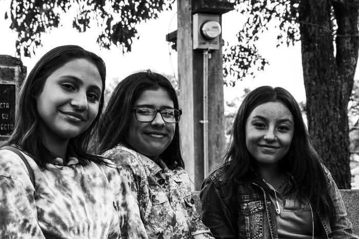 colegialas Costa Rica Heredia, Costa Rica Barva Walking Around Taking Pictures Streetphotography Smile Pinhole Pinhole Photography Black And White Canon EoS Rebel T6 Friendship City Tree Young Women Portrait Smiling Togetherness Happiness Looking At Camera Standing