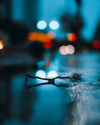 Close-up of wet illuminated lights in rainy season