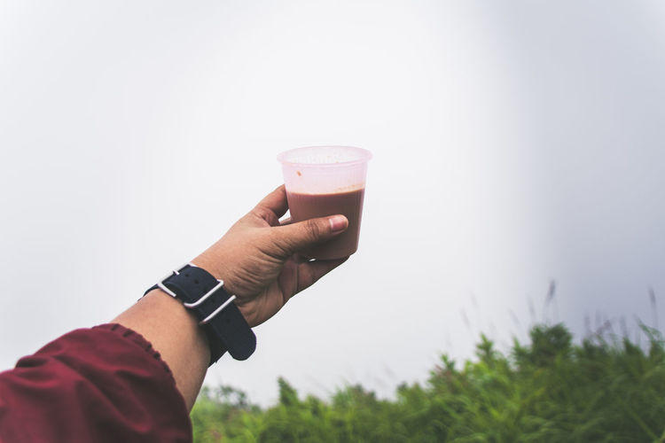 Coffee Body Part Close-up Drink Drinking Glass Finger Focus On Foreground Food And Drink Freshness Glass Hand Holding Human Body Part Human Hand Human Limb Lifestyles Nature One Person Personal Perspective Real People Refreshment Food And Drink Nature