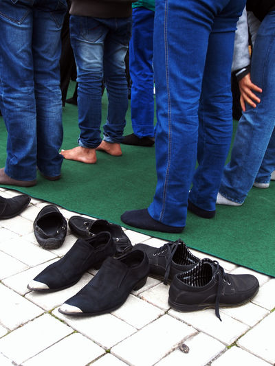 Muslims congregate to celebrate Muslim holiday of Eid al-Adha, Great Mosque, Lugansk, Ukraine Adult Adults Only Casual Clothing Celebrate Close-up Congregate Day Eid Al-Adha Great Growth Holiday Human Body Part Human Leg Indoors  Jeans Low Section Lugansk Men Mosque Muslim Muslims Only Men People Shoe Togetherness