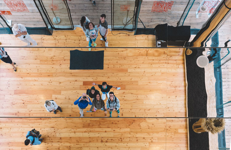 Expo group Abandoned Balance Casual Clothing Childhood Door Enjoyment Expo Expo2015 Expo2015milano Fuji X100s FUJIFILM X100S Full Length Fun Group Indoors  Lifestyles Milano Occupation Old Plank Sitting Text Wall Wall - Building Feature Wood Wood - Material Wooden X100S