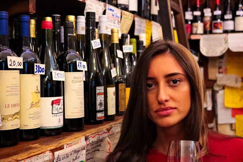 Wine Moments Bottle Wine Beauty Women One Person Beautiful People Lifestyles Retail  Liquor Store Alcohol Young Women Adult Shelf Young Adult Adults Only Indoors  Only Women One Woman Only People Wine Rack