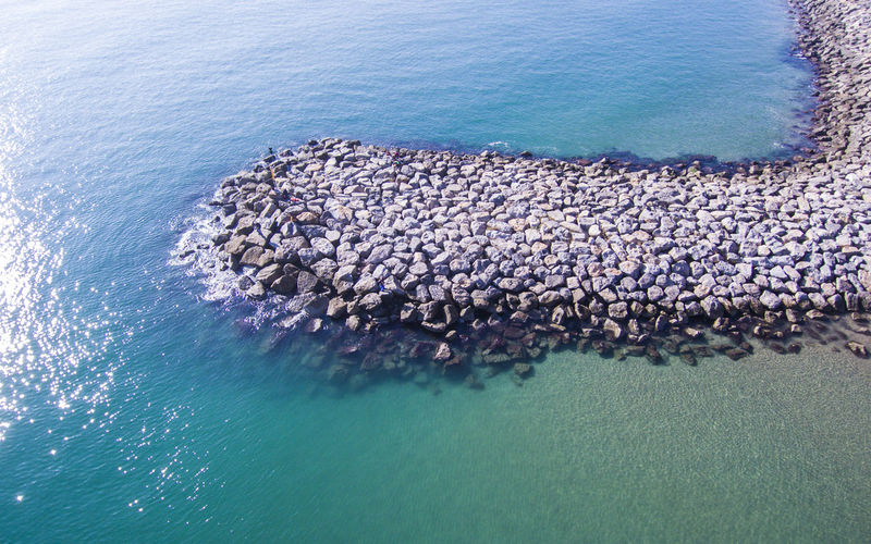 Aerial view of groynes at sea shore