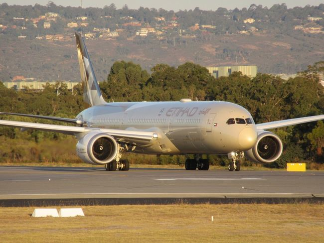 Etihad Airways Boeing 787-9 Dreamliner taxiing to the runway for departure to Abu Dhabi. Airplane Transportation Air Vehicle Airport Runway Airport Mode Of Transport Perth Airport Aircraft Wing Commercial Airplane Airfield Day Flying Aerospace Industry Aircraft No People Outdoors Sky First Class Boeing 787