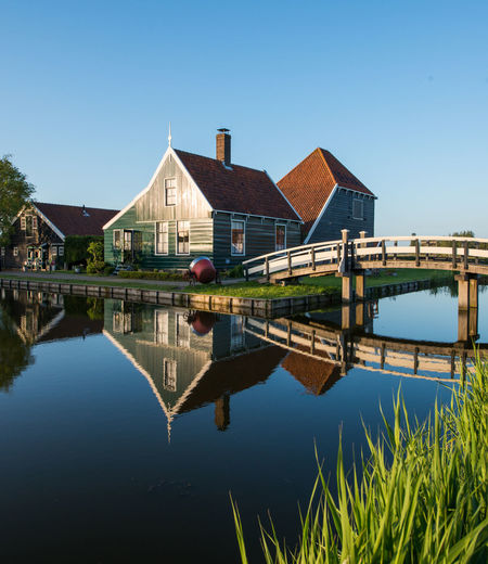 Zaanse schans, Holland - Traditional Dutch village Architecture Beauty In Nature Blue Built Structure Canal Clear Sky Connection Day Grass Green Color Growth Nature No People Outdoors Plant Reflection River Scenics Sky Standing Water Tranquil Scene Tranquility Water