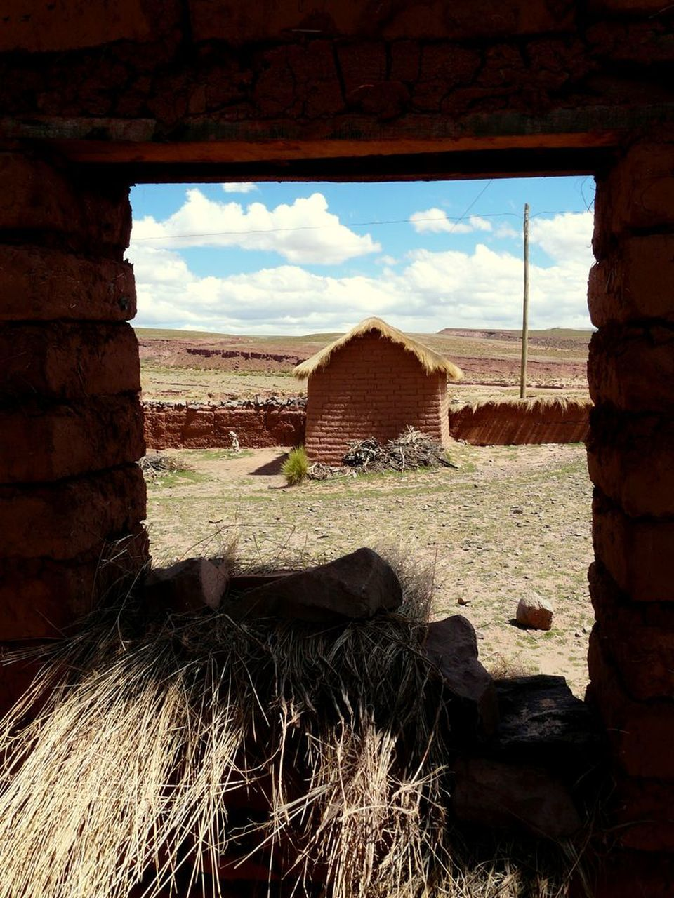 sky, cloud - sky, window, built structure, architecture, day, field, no people, building exterior, landscape, old ruin, rural scene, nature, agriculture, indoors, scenics, beauty in nature
