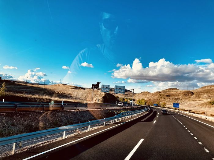 Panoramic view of highway against blue sky