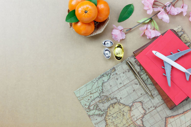 High Angle View Of Oranges And Map On Table