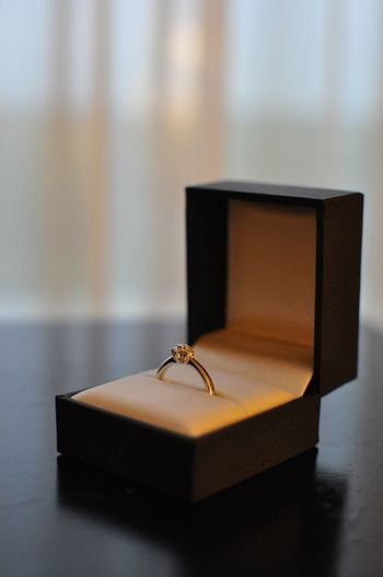 Close-up of ring in box on table