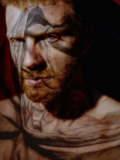 Young bearded man portrait, red hair, layered, body paint, traces, psychology, looking at camera