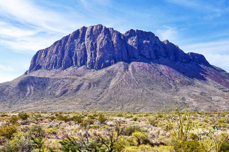 The Nugent Mountain in the Big Bend National Park in the USA. Nugent Mountain Plants Rock Formations Texas USA Beauty In Nature Big Bend National Park Clouds Day Landscape Mountain Nature No People Outdoors Plain Scenics Sky Tranquil Scene Tranquility