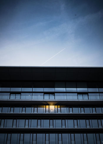 Built Structure Architecture Building Exterior Sky Low Angle View Building City Cloud - Sky No People Blue Nature Vapor Trail Modern Office Office Building Exterior Outdoors Window Glass - Material Day Dusk Skyscraper