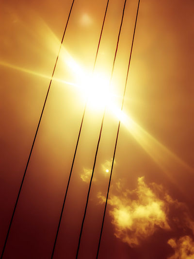 Low Angle View Of Bright Sun At Sunset