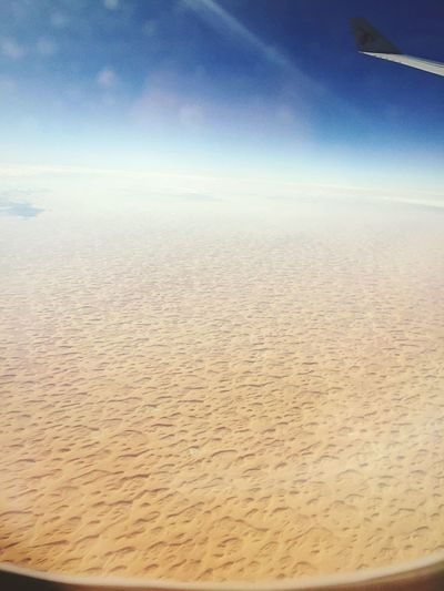 Above The Clouds Nature Beauty In Nature Sky Scenics Airplane Tranquility Aerial View Tranquil Scene Transportation No People Sea Day Outdoors Journey Landscape Cloud - Sky Airplane Wing Water Sand Kuwait Gulf